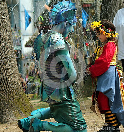 Girl meets fairy at the faire Editorial Stock Image