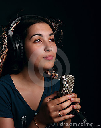 Girl with a microphone and head-phones
