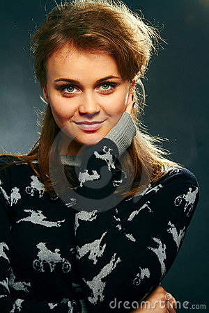 Girl model on a dark background.
