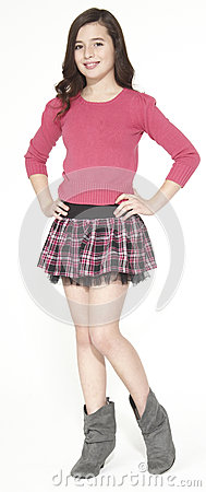 Free Girl Model Posing In A Plaid Skirt And Ankle Boots Royalty Free Stock Photography - 39727057