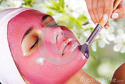 Girl with moistening fruit facial mask