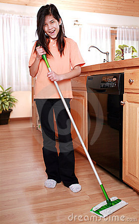 Girl mopping kitchen floor