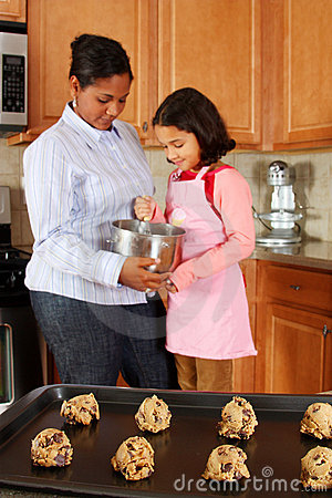 Girl And Mother With Cookies