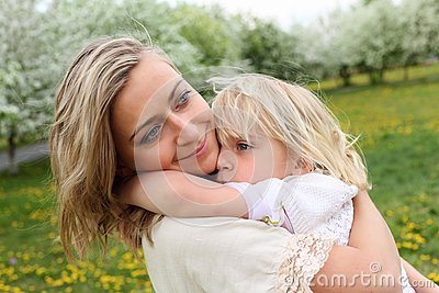 Girl with mother in the park
