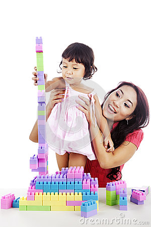 Girl with mother playing lego