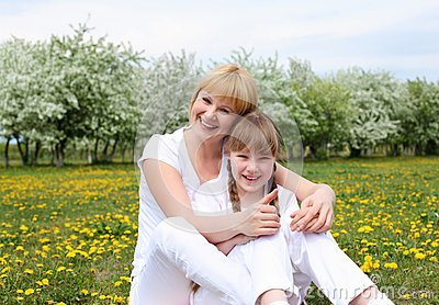 Girl with mother in spring park