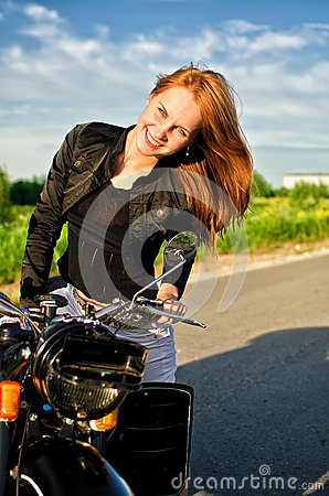Girl on a motorbike on a road