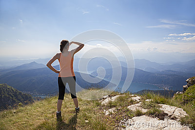 Girl on mountain top looking