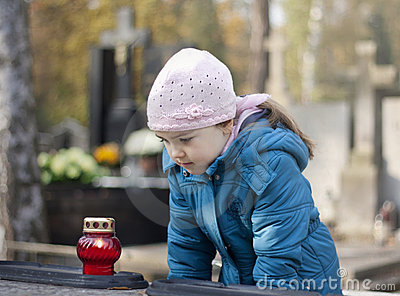 Girl mourning at the grave