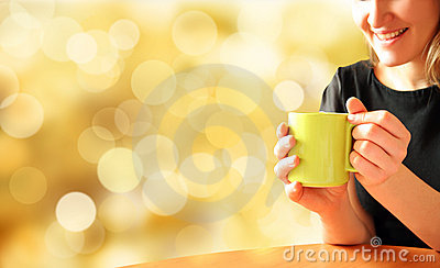 Girl with mug of tea on bright background