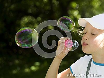 Girl and  multi-colored  soap  bubbles