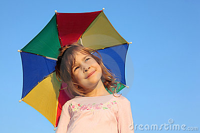 Girl with multicolor rainbow umbrella