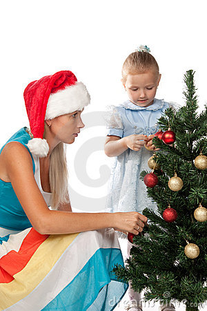 Girl with mum decorates a Christmas tree
