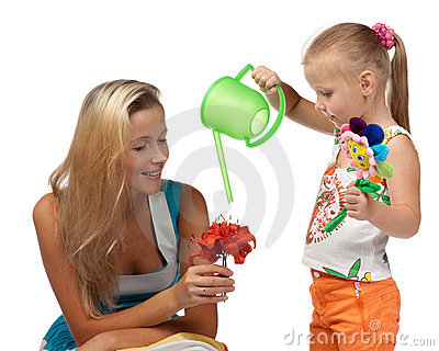 Girl with mum water a flower