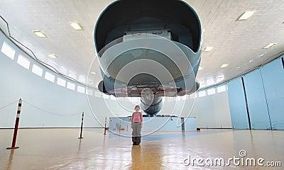 Girl near big centrifuge Editorial Stock Photo