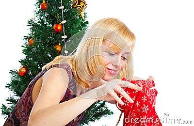 Girl near Christmas fir tree
