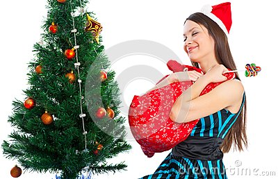 Girl near Christmas fir tree
