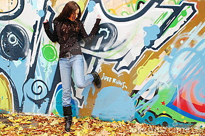Girl near the graffiti wall