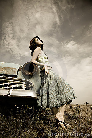 Girl near old car
