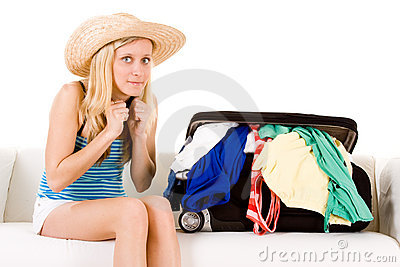 Girl near overstuffed suitcase