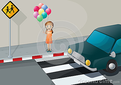 A girl near the pedestrian lane holding balloons