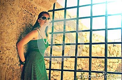 Girl near prison bars