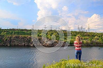 The girl near the river looks afar