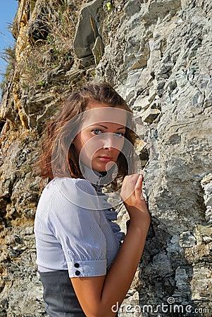 The girl near a rock