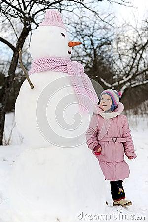 Girl near snowman