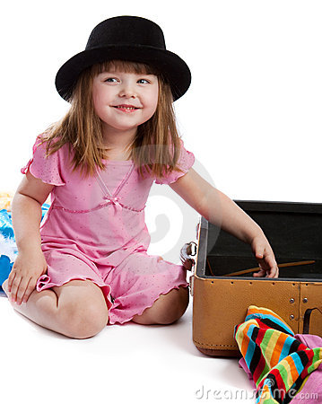 Girl near suitcase