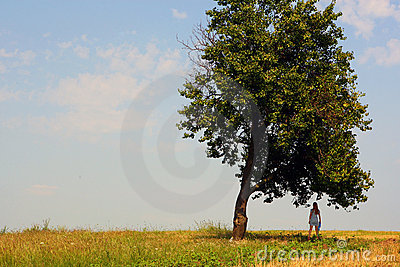 Girl near a tall tree
