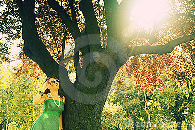 Girl near tree with sun flare