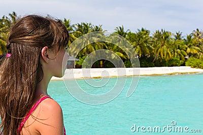 Girl near tropical beach