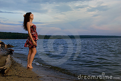 Girl near water on sea coast