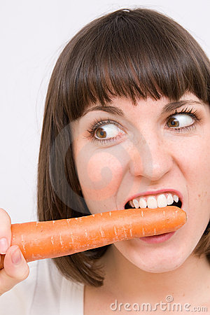 Free Girl Nibble Carrot Royalty Free Stock Images - 7295609
