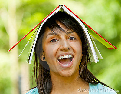 Girl with notebook on her head