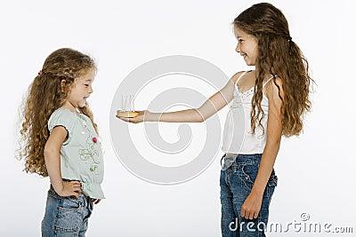 Girl offering bithday cake