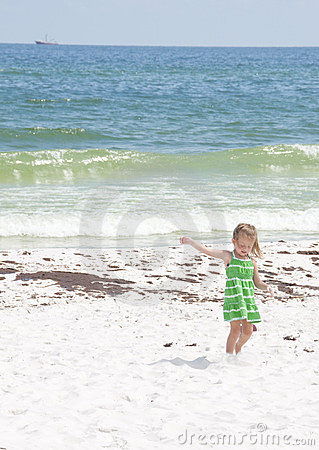 Girl by oil on Pensacola Beach Editorial Photo