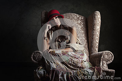 Girl in old armchair