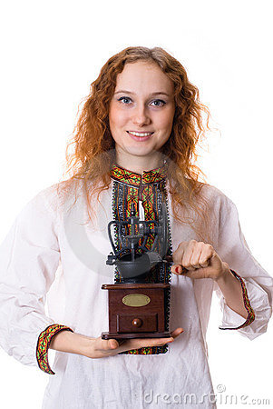 Girl with an old coffee grinder