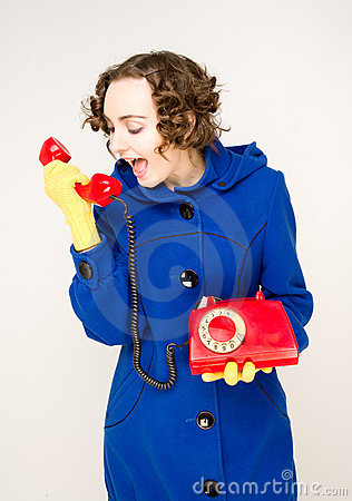 Girl with old red telephone