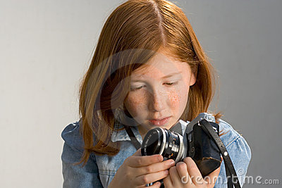 Girl with old SLR photo camera