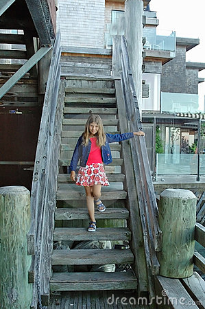 Girl and old wooden stairs