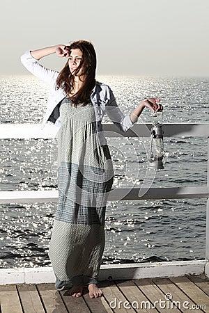 Free Girl On Pier With Kerosene Lamp Royalty Free Stock Photo - 30895225
