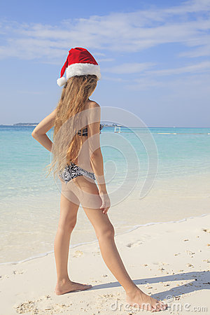 Free Girl On The Maldivian Beach In Santa Hat Stock Image - 40254281