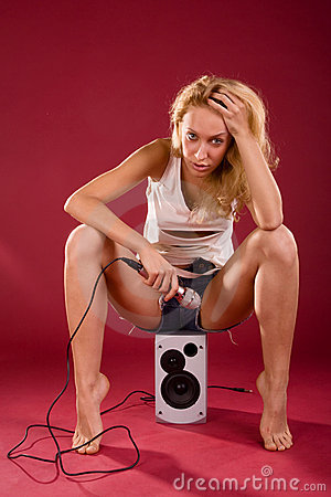 Free Girl On The Sound Speaker Royalty Free Stock Photography - 13794377