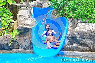 A girl ond a boy a slide