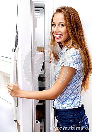 Girl open a refrigerator