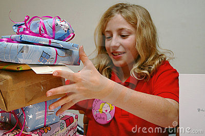 Girl opening birthday presents