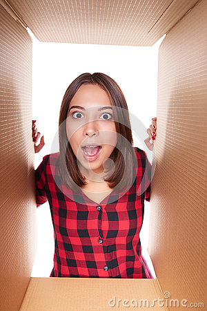 Girl Opening A Carton Box And Looking Inside Stock Photo ...